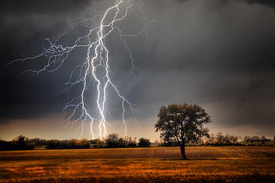 Lightning striking a field